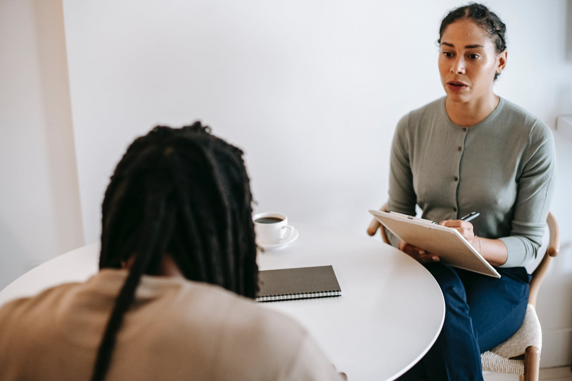 professional female psychotherapist discussing therapy results with male client