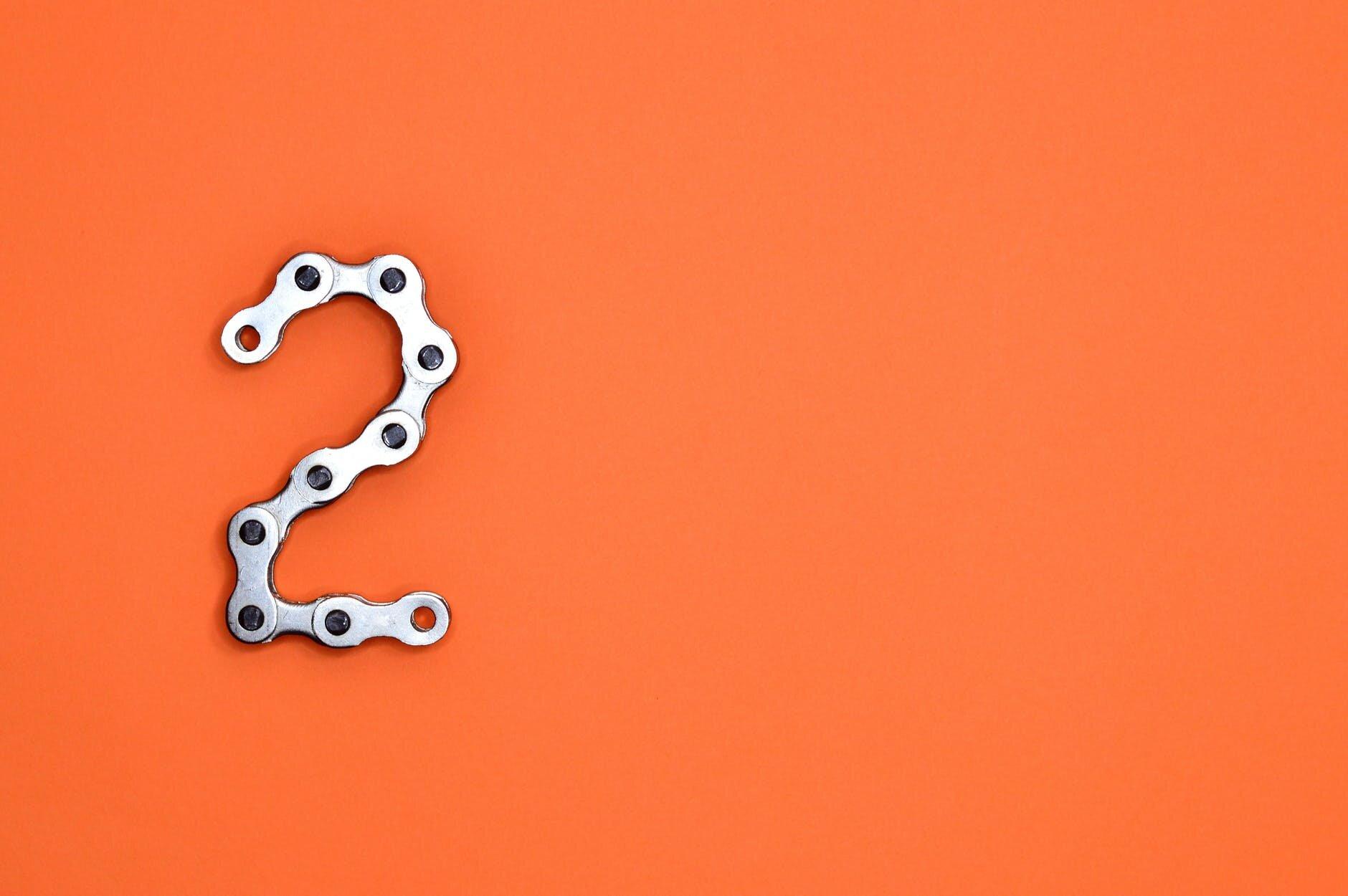 gray steel chain on orange surface